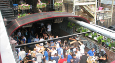 The Beer Garden on the Main Floor features a retractable rooftop, beautiful plant life, and a private entrance. Doors are able to slide open to the Main Room to create a more open atmosphere.